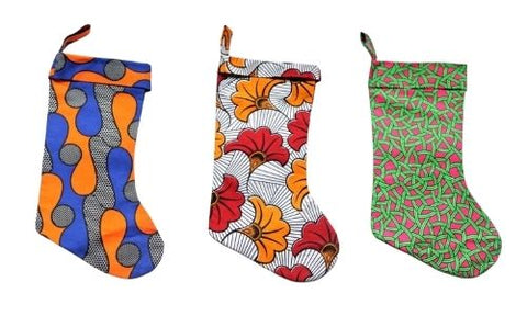 Three of TinyTuLondon's African print-inspired Christmas Stockings
