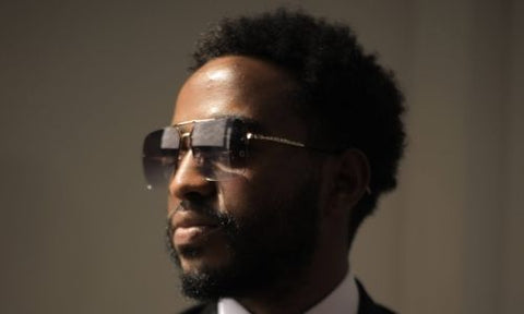 Black man with full beard and sunglasses