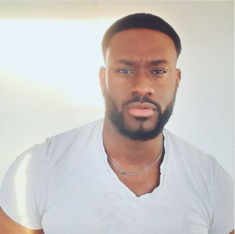 Black man with short hair and beard