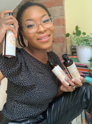Rachael Corson holding Afrocenchix products for Rosa Parks Black HairStory