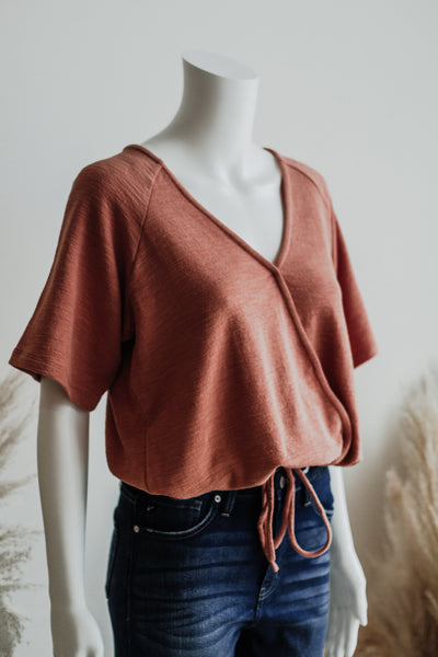 PLACID LAKE WRAP TOP IN APRICOT