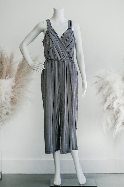 CASSA STRIPE SURPLICE JUMPSUIT IN BLACK + WHITE