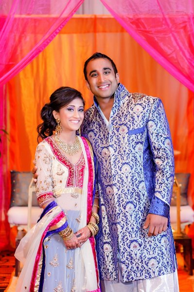 Brides Custom Made Sangeet Lehenga with long jacket and Grooms Indo-Western Matching Sherwani.