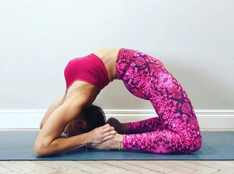 Camel pose in snake hips pink blossom yoga leggings
