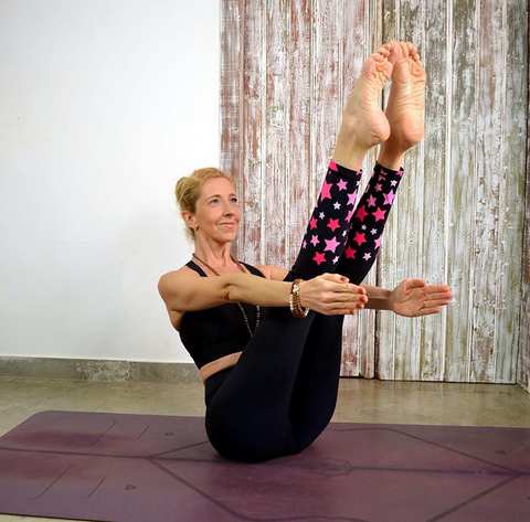 Boat Pose in Yoga  Blossom Yoga Wear  Blog to build a strong core. Eco friendly Wonder woman Leggings