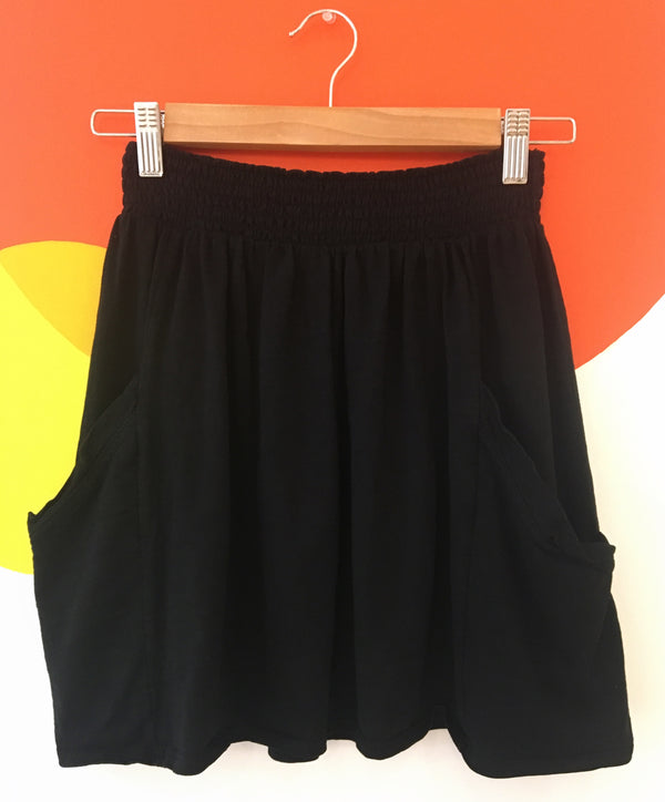 Black mini skirt with pockets