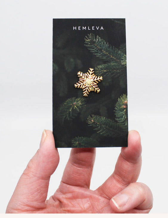 Gold plated snowflake pin