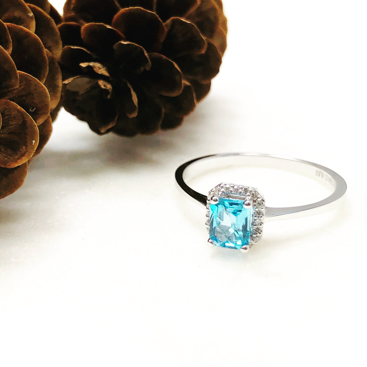 14K White Gold Blue Topaz and Diamond Ring.