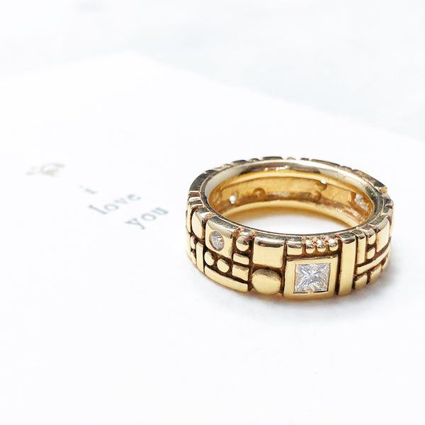 14K Yellow Gold Diamond Band.