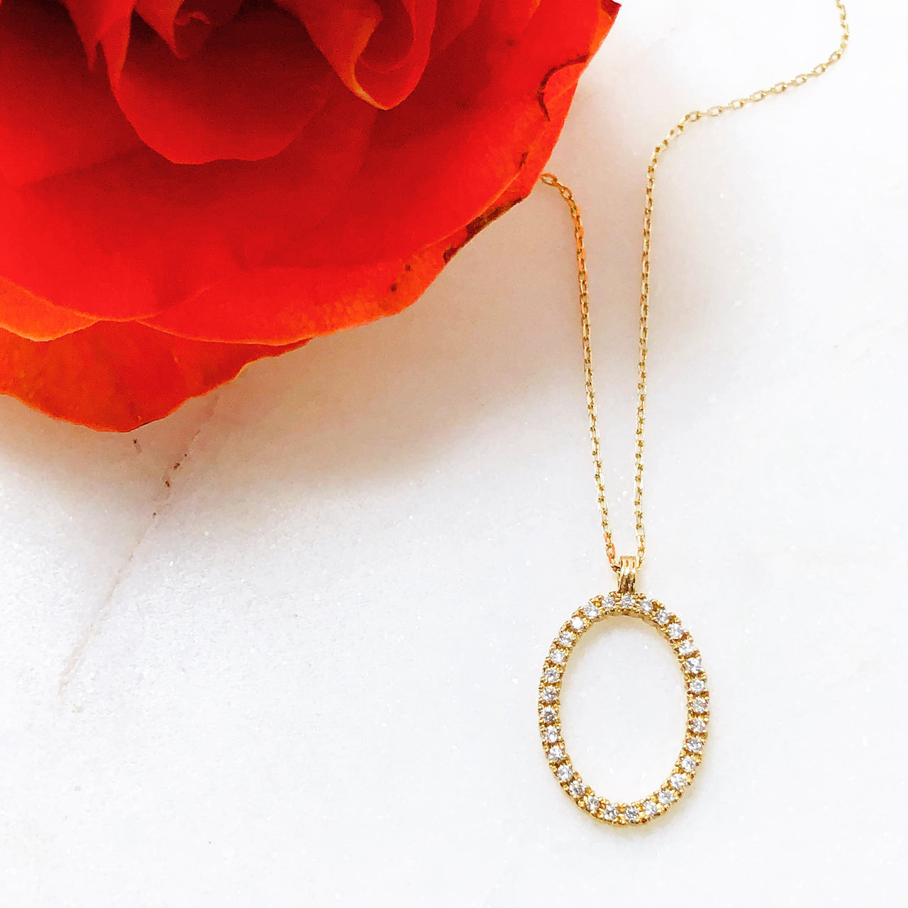 14K Yellow Gold Oval Diamond Necklace.