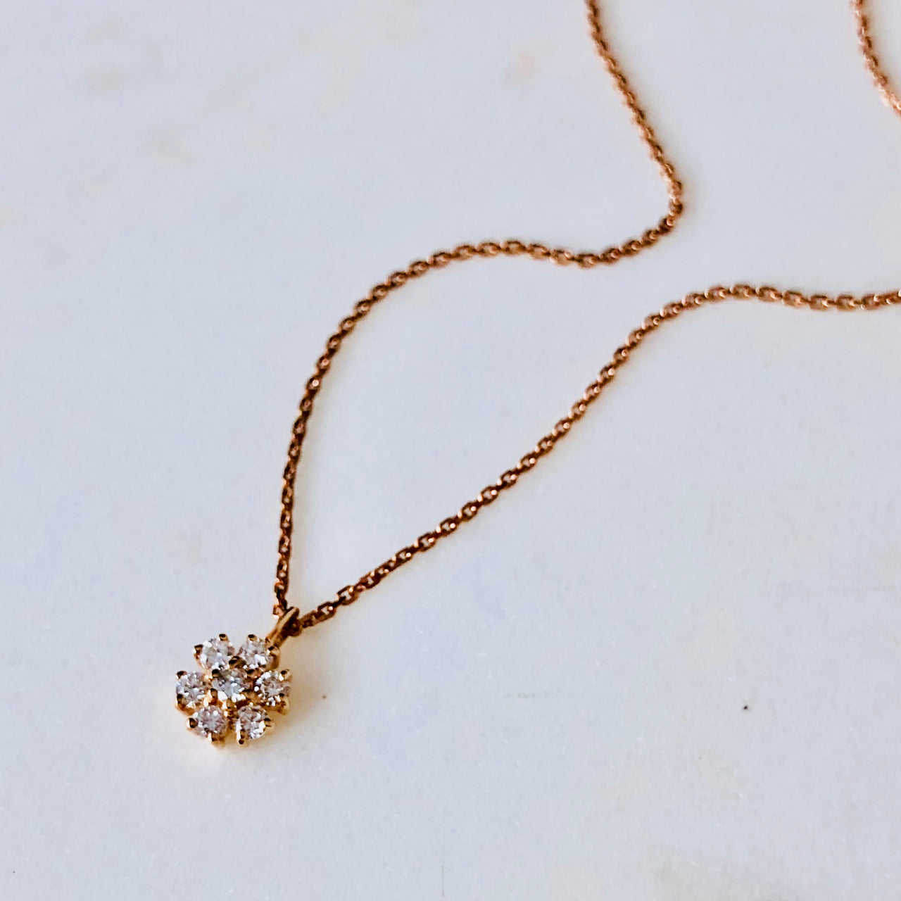 14K Rose Gold Pinwheel Diamond Necklace.