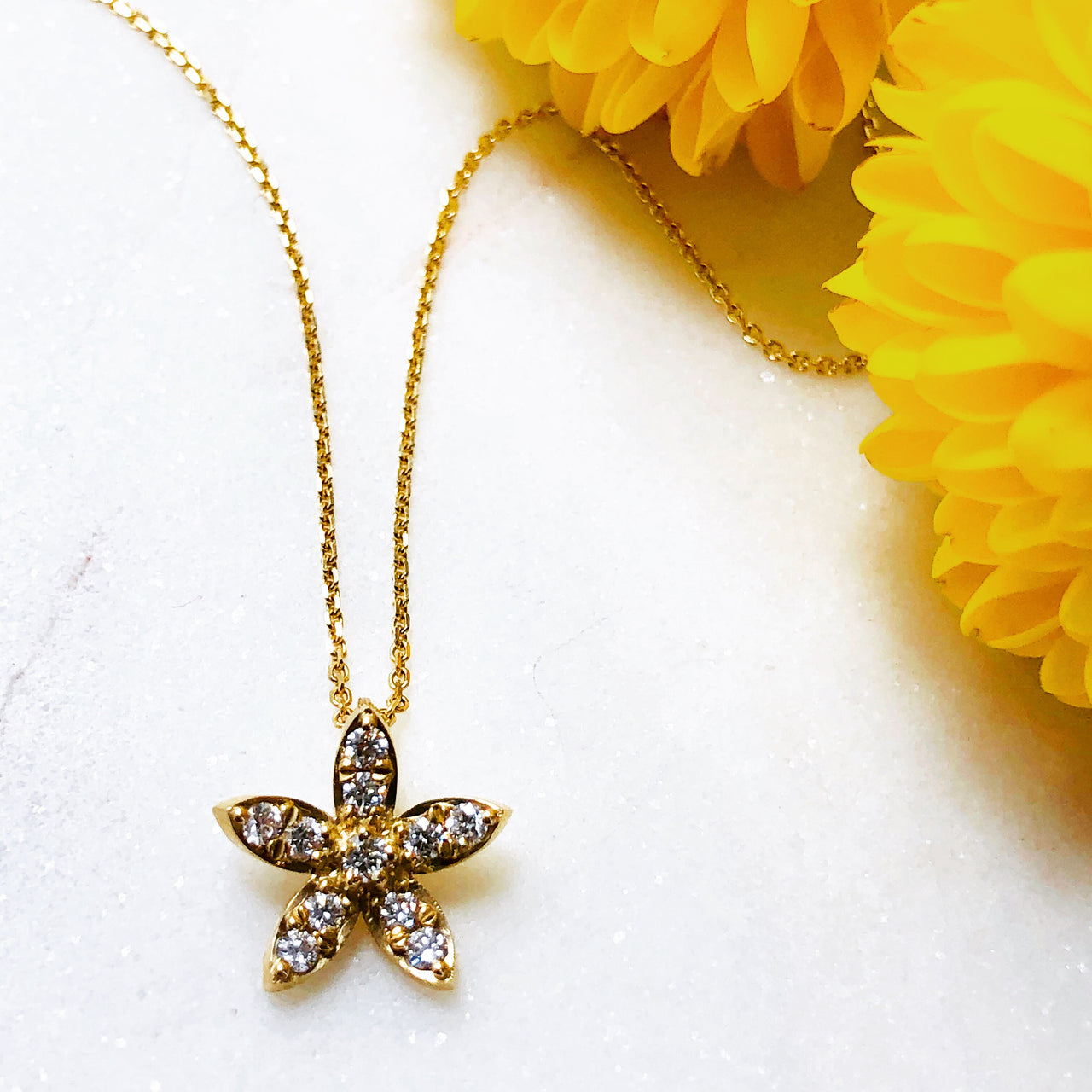 14K Yellow Gold Star Diamond Pendant.