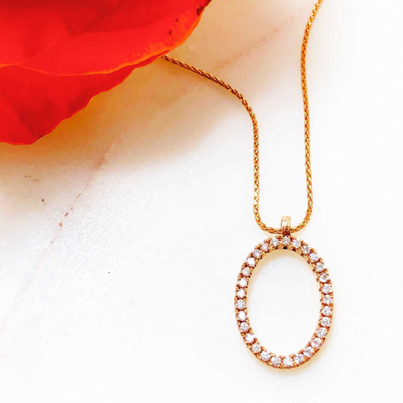 14K Rose Gold Oval Diamond Necklace.