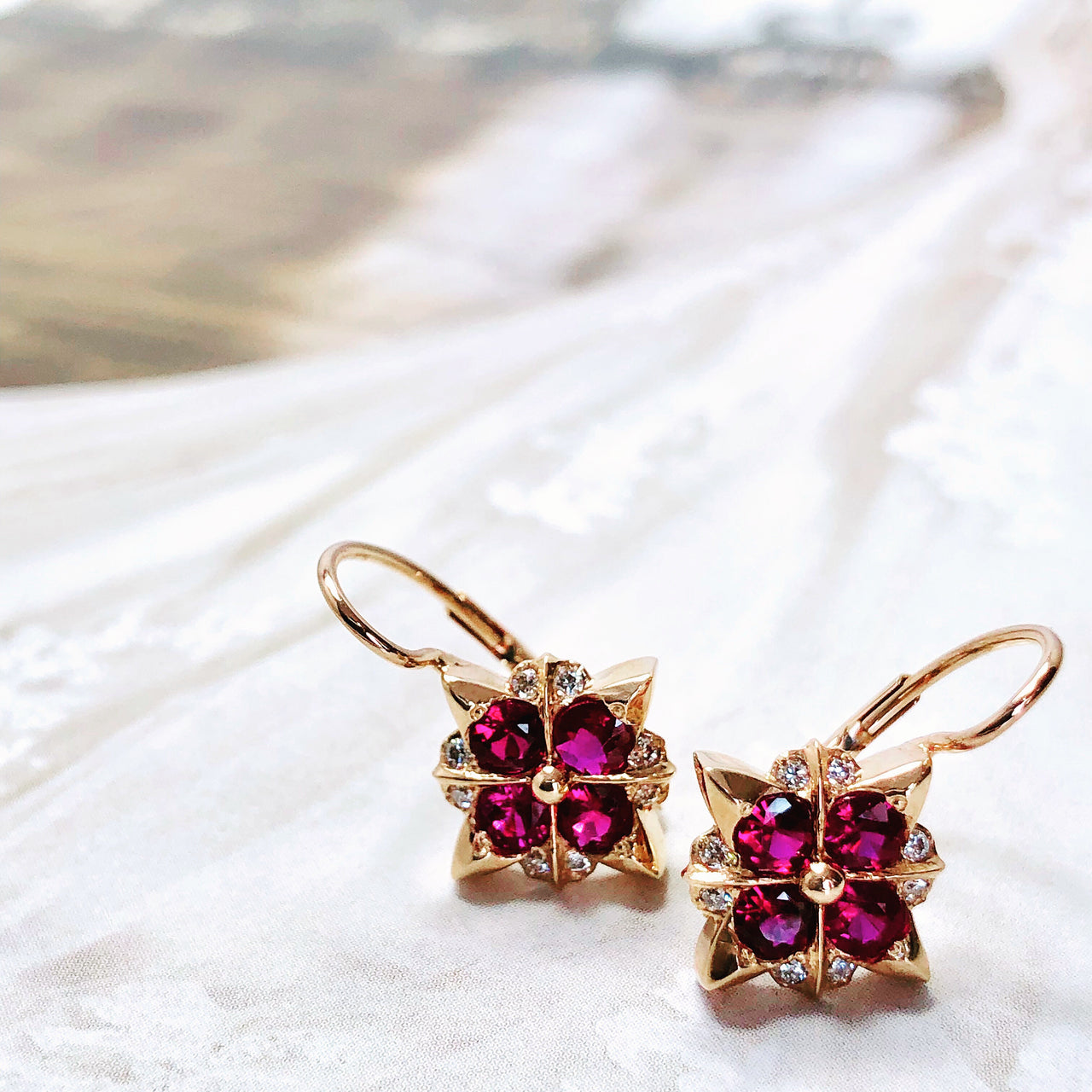 14K Rose Gold Ruby and Diamond Earrings.