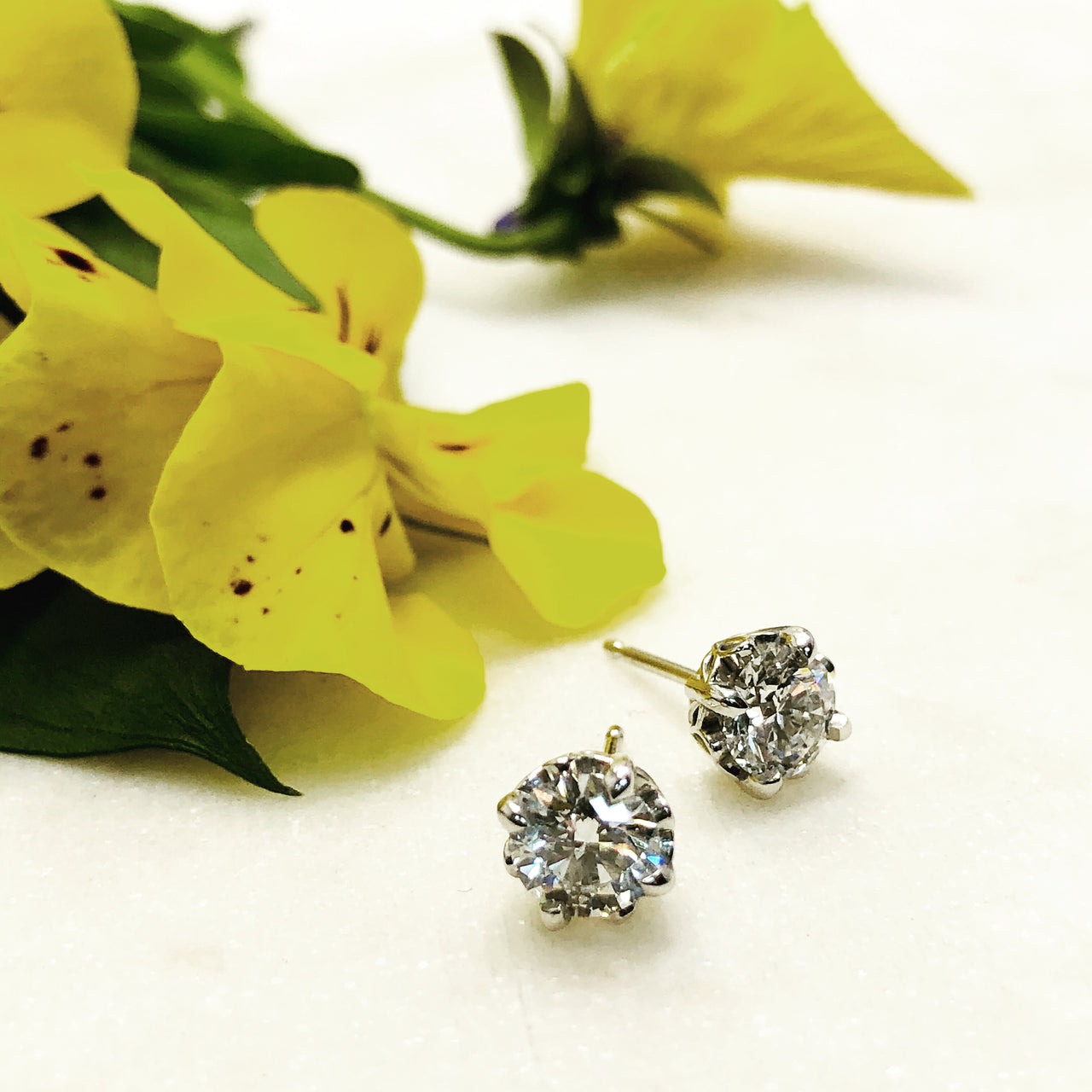 14K White Gold Diamond Earrings.