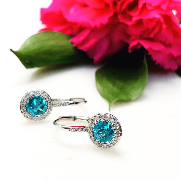 14K White Gold Blue Topaz and Diamond Earrings.