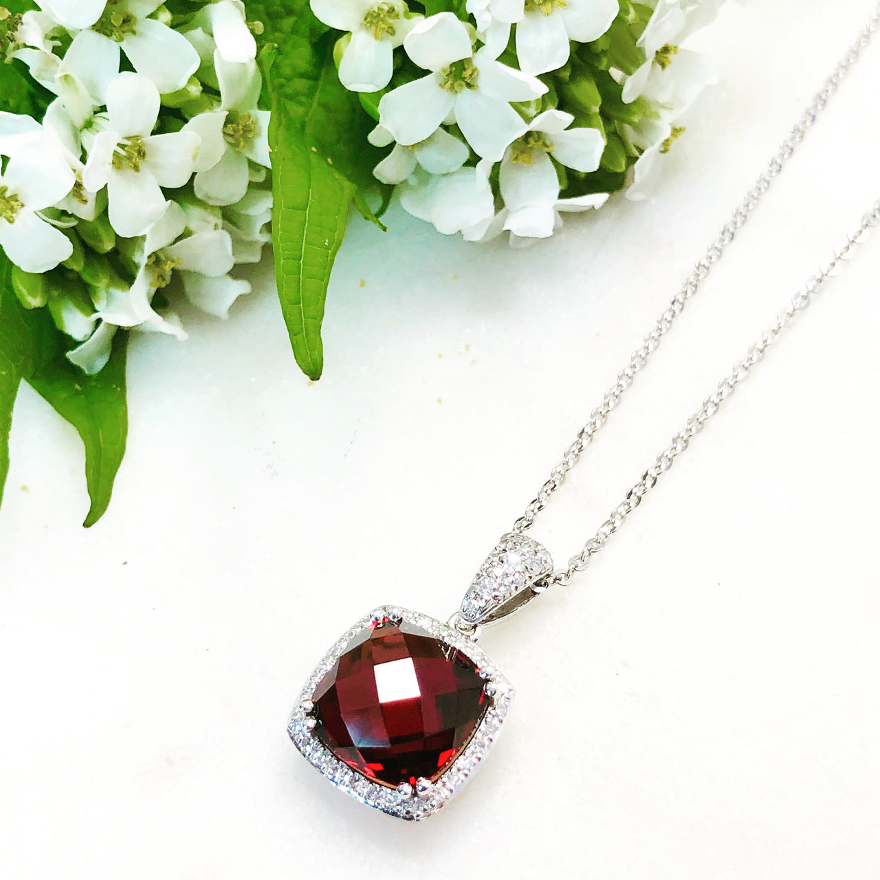 14K White Gold Garnet and Diamond Necklace.