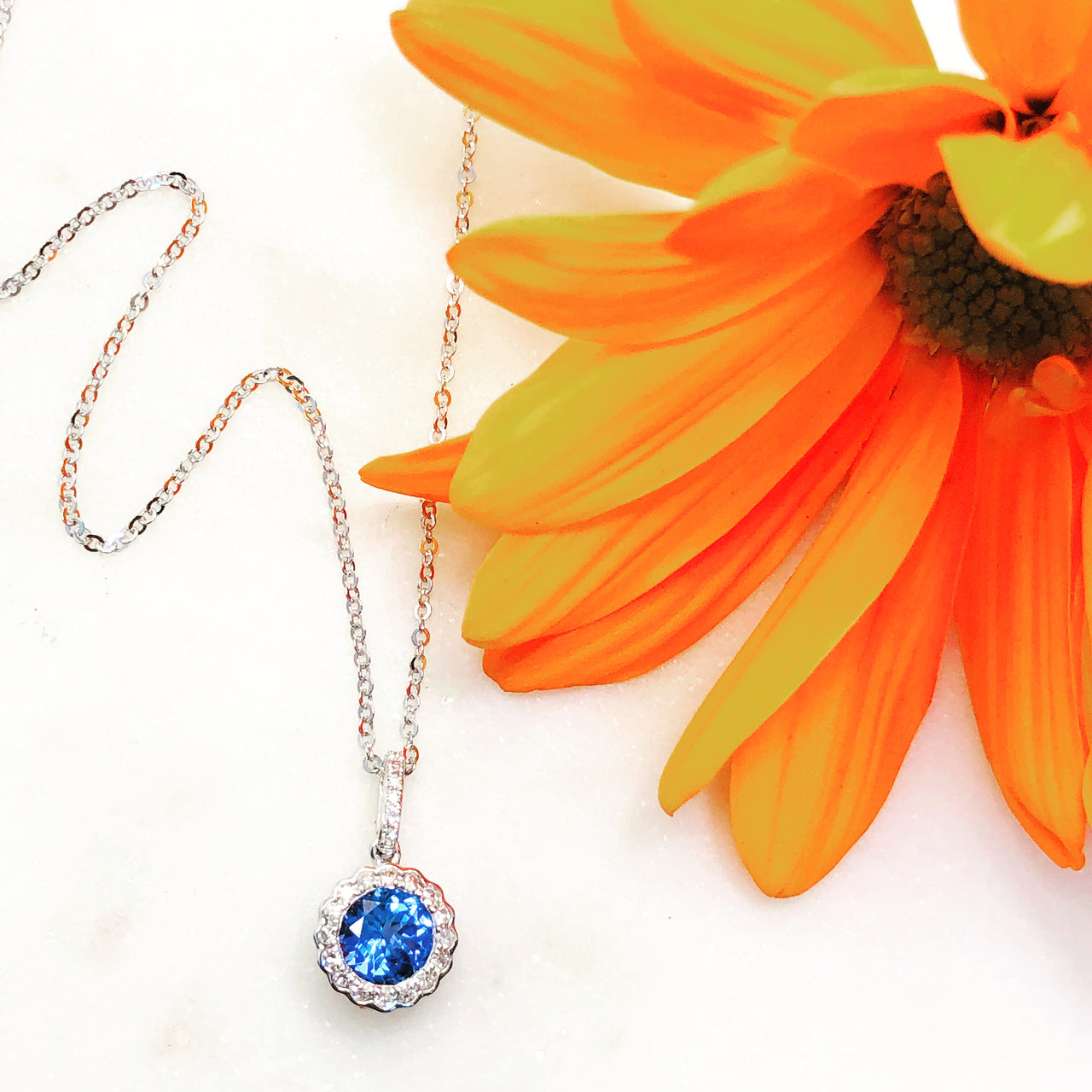14K White Gold Blue Topaz and Diamond Necklace.
