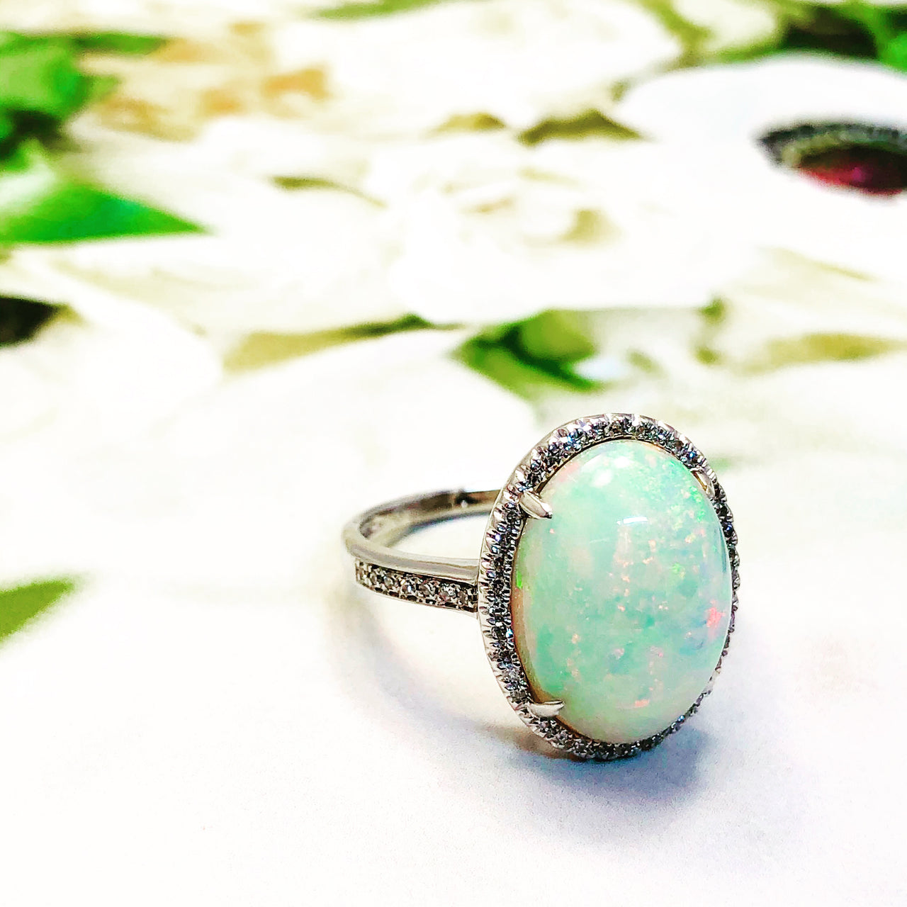 14k White Gold Opal and Diamond Ring.