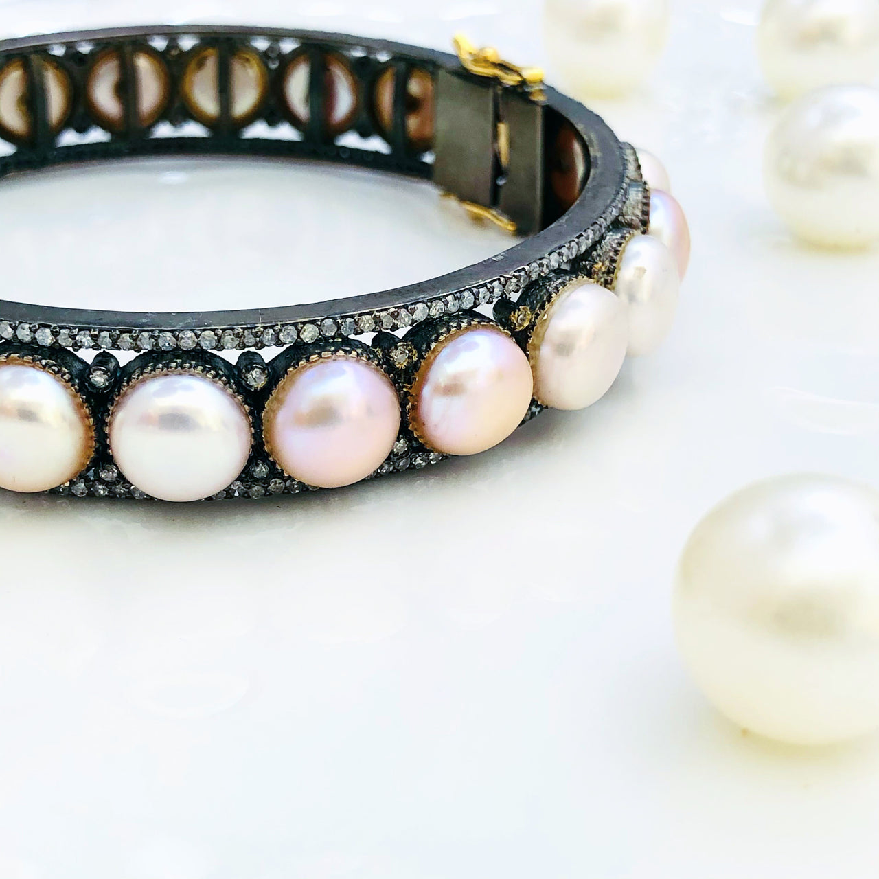 Sterling Silver Pearl and Diamond Bracelet.