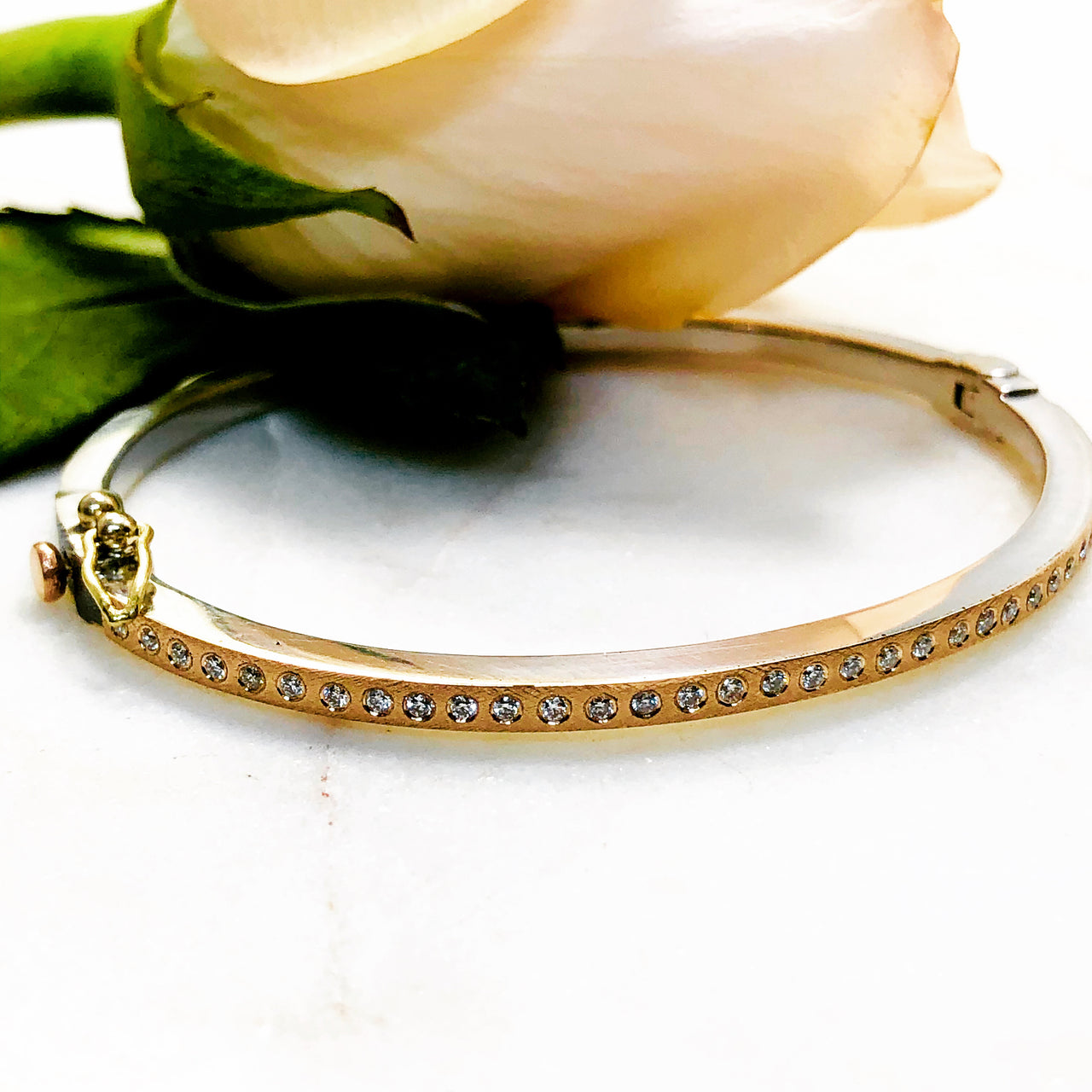 Sterling Silver and 18K Rose Gold Diamond Bracelet.