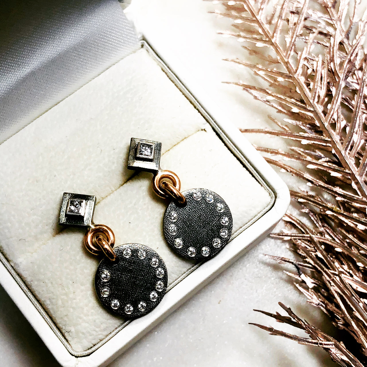 Sterling Silver and 18K Rose Gold Diamond Earrings.