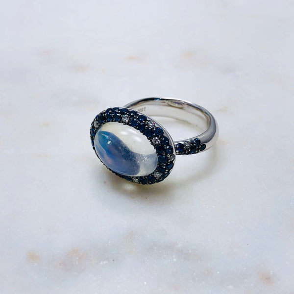 18K White Gold Moonstone, Sapphire & Diamond Ring.