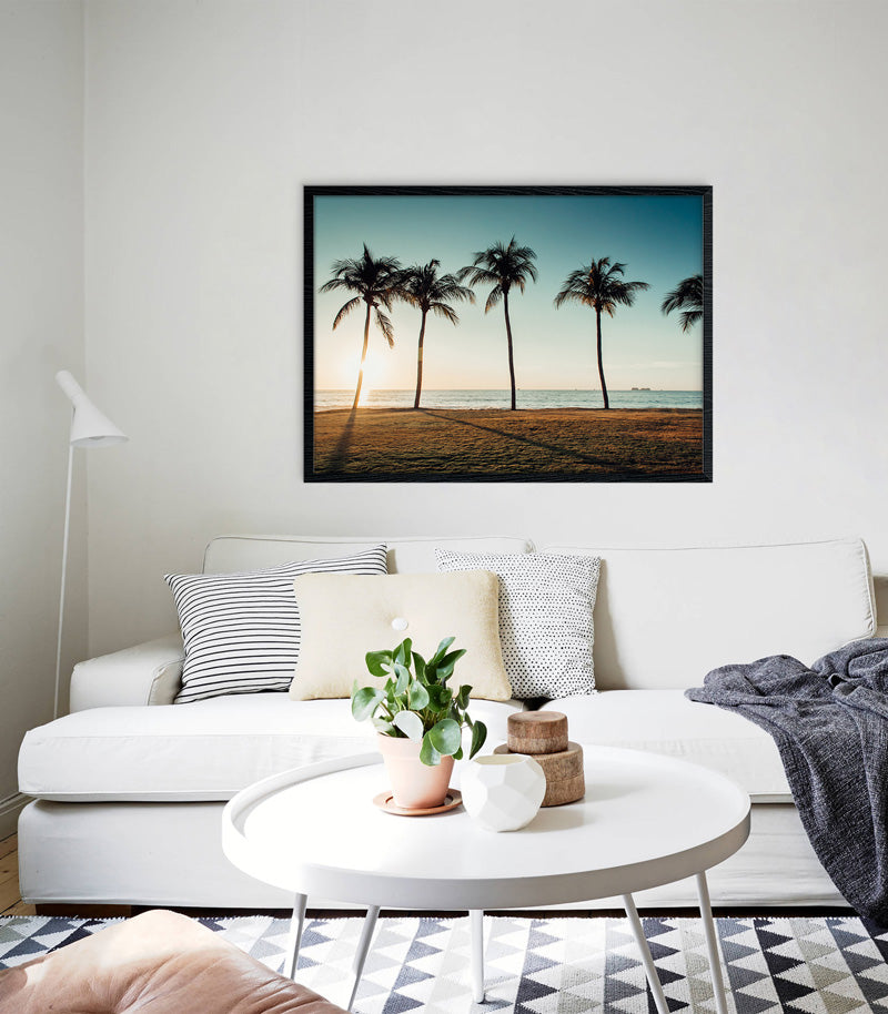 Beautiful palm tree beach print hanging over a white coach. The Sunset Shop by Samba to the Sea.