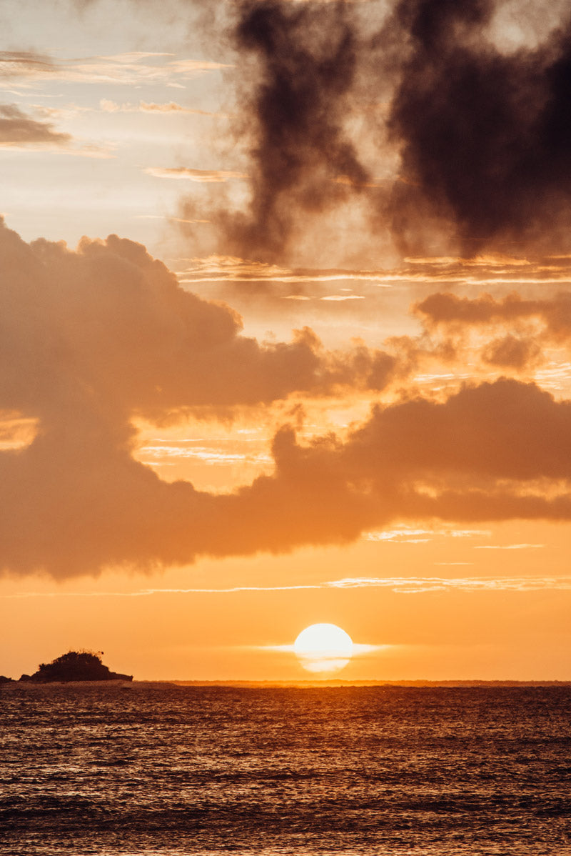 Sun passing over the Pacific Ocean in Costa Rica. Photographed by Kristen M. Brown, Samba to the Sea for The Sunset Shop.