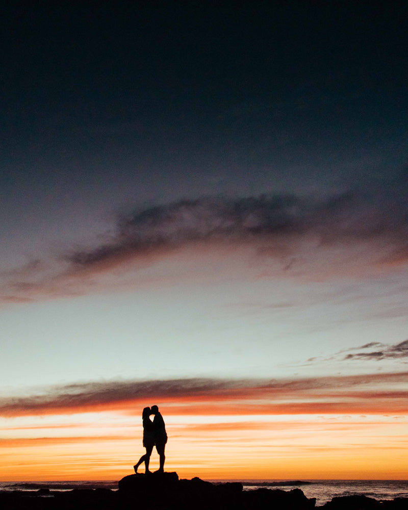Couple kissing during sunset in Costa Rica. Sunset art pictures photographed by Kristen M. Brown, Samba to the Sea for The Sunset Shop.