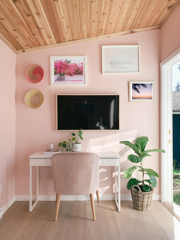 Work from home office with all the beach vibes. Lindsay from Sincerely Lindsay Design Co. created a dreamy backyard office space with the help of sunset and beach photo wall art photographed by Kristen M. Brown of Samba to the Sea. Beach photo prints available at The Sunset Shop.