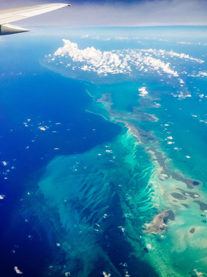 701013957dd Turquoise blue waters of the Caribbean sea from the airplane. Photographed  by Kristen M.