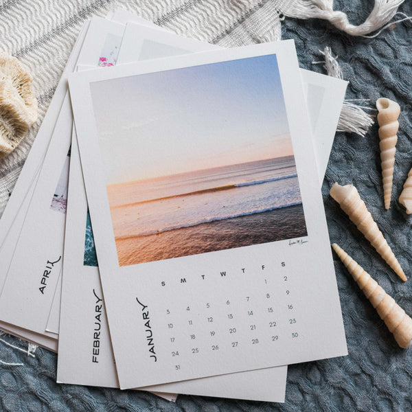 Now you can wanderlust away to your happy place while you're working with the desktop photo calendar! Dream away to a new location each month, and after the month is over, you can cut away the month on the bottom and frame the print!