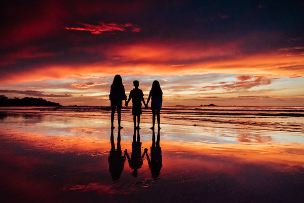 Sunset family photo in Tamarindo Costa Rica. Photographed by Kristen M. Brown, Samba to the Sea Photography.