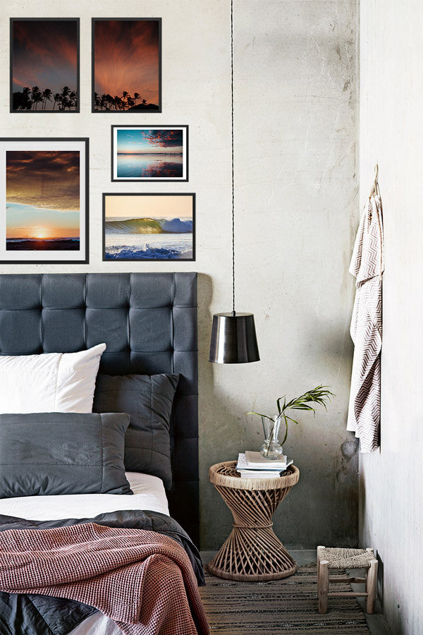 Gallery wall sunset images above bed. Sunset prints by Samba to the Sea at The Sunset Shop.