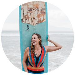 Portrait of Kristen M. Brown of Samba to the Sea with her surfboard in Tamarindo Costa Rica.