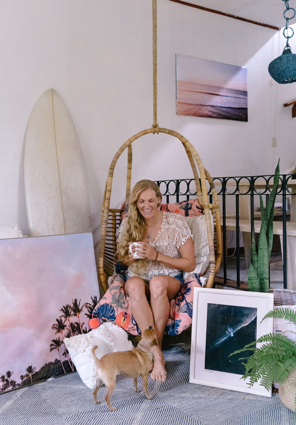 Photographer Kristen M. Brown @sambatothesea at home in Tamarindo, Costa Rica with her sunset and beach photo prints from The Sunset Shop.