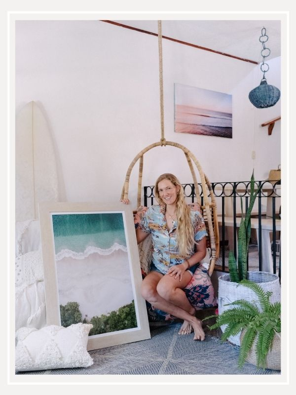 Destination Costa Rica photographer Kristen M. Brown at home with her sunset and beach photography prints. Boho surf shack in Tamarindo, Costa Rica. Samba to the Sea for The Sunset Shop.