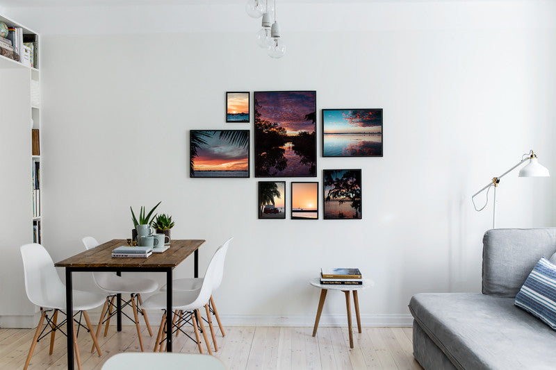 Gallery Wall Tips Roundup from the Experts. Gallery wall in living room with sunset images from Samba to the Sea at The Sunset Shop.