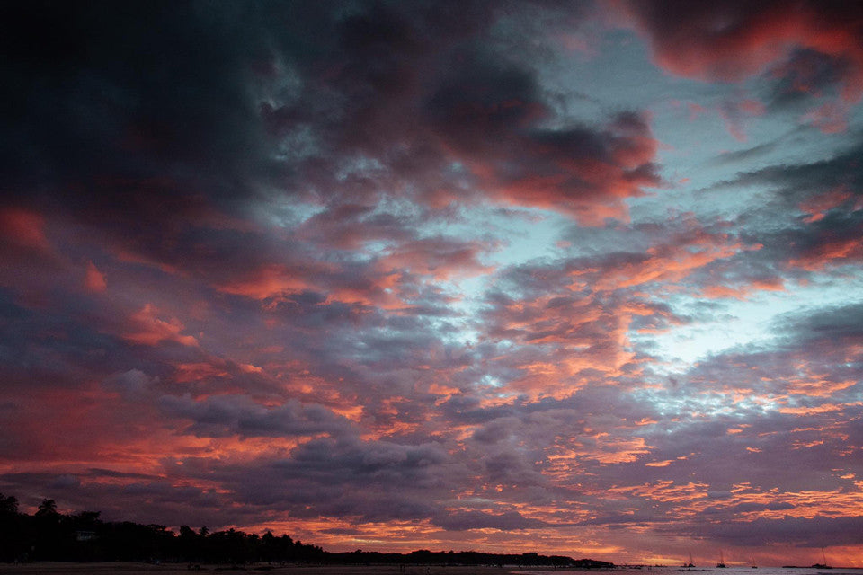 Magenta sunset clouds in Tamarindo, Costa Rica. Photographed by Kristen M. Brown, Samba to the Sea.