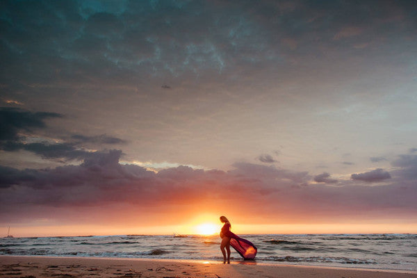 Maternity photograph during a gorgeous sunset in Tamarindo, Costa Rica. Photographed by Kristen M. Brown, Samba to the Sea at The Sunset Shop.
