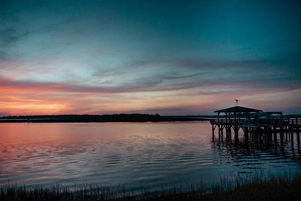Sunset over the marsh and dock in Savannah, Georgia. Photographed by Kristen M. Brown, Samba to the Sea for The Sunset Shop.