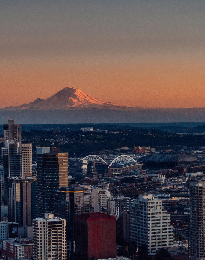 Sunset sky in Seattle Washington. View of Mount Rainier from the Space Needle at sunset. Photographed by Kristen M. Brown, Samba to the Sea for The Sunset Shop.