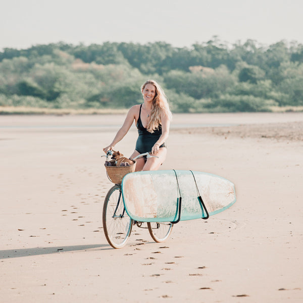 Photographer Kristen M. Brown riding her bike on the beach in Tamarindo, Costa Rica.