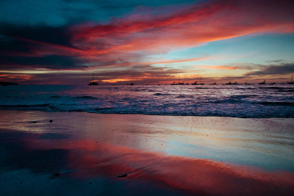 Pink sunset in Tamarindo, Costa Rica. Photographed by Kristen M. Brown, Samba to the Sea. Sunset print at The Sunset Shop.