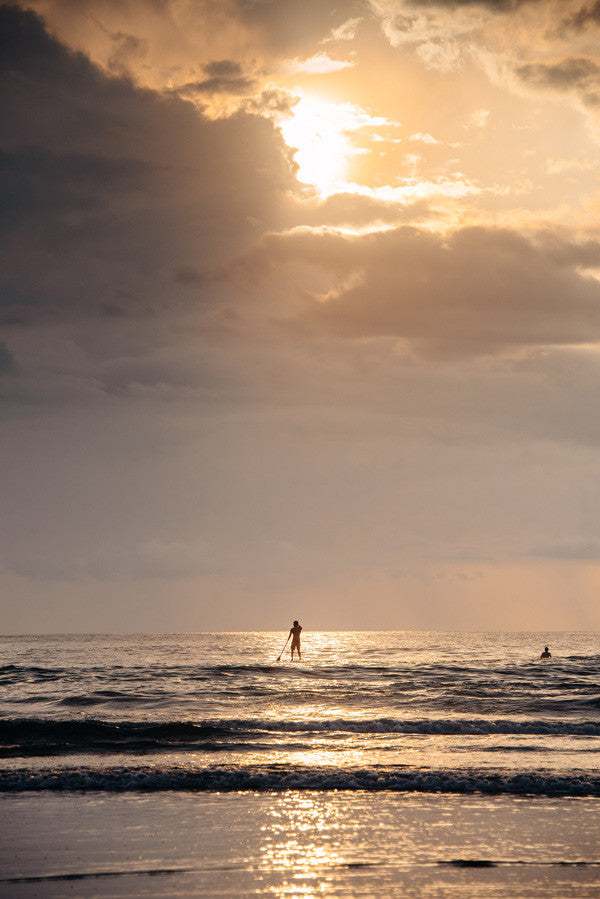 Stand Up Paddle boarding at sunset in Tamarindo, Costa Rica.Photographed by Kristen M. Brown, Samba to the Sea at The Sunset Shop.