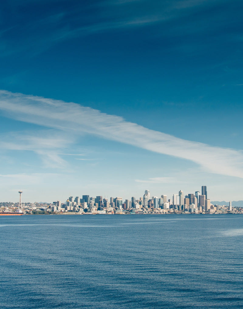 Blue skies Seattle Washington Skyline. Photographed by Kristen M. Brown, Samba to the Sea for The Sunset Shop.