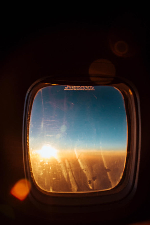 Sunset from the air on United Airlines. Photographed by Kristen M. Brown, Samba to the Sea at The Sunset Shop.