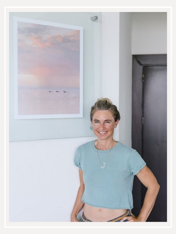 At home with Julie Gohring of Saltwater Fit. Changing artwork with beach photos to create a beach escape in a home. Sunset and beach photos prints of Costa Rica by Kristen M. Brown of Samba to the Sea for The Sunset Shop.