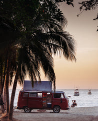 WW bus on the beach under a palm tree in Tamarindo, Costa Rica by Kristen M. Brown, Samba to the Sea.